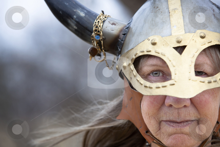 Viking Woman stock photo, Closeup portrait of Viking woman in helmet with horns by Scott Griessel
