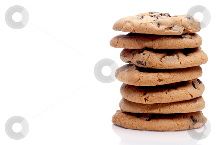 A horizontal image of a stack of 7 chocolate chip cookies on a w stock photo, A horizontal image of a stack of 7 chocolate chip cookies on a white reflective surface with space for copy by Vince Clements