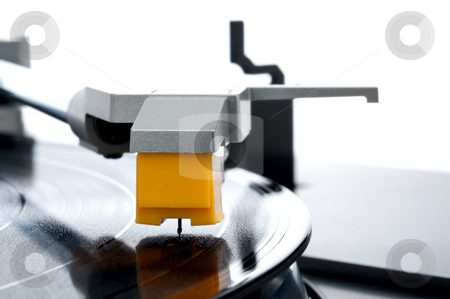 A horizontal macro of a vinyl record be played on a turntable stock photo, A horizontal macro of a vinyl record be played on a turntable by Vince Clements
