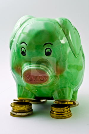 Piggy bank stock photo, Piggy bank standing on some coins by Damir Franusic