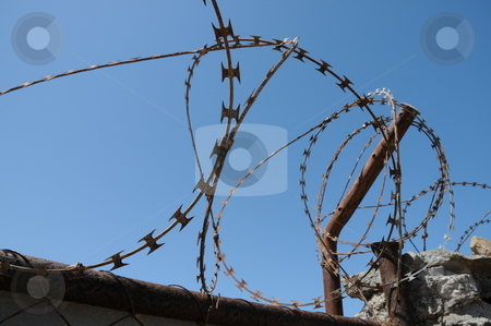 Barb wire fence stock photo, Barb wire fence in Luderitz, Namibia by Damir Franusic