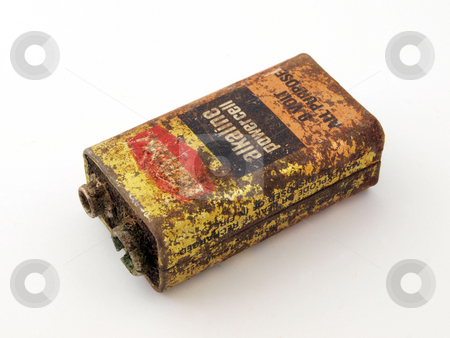 Rusty battery stock photo, Old, flat rusty battery ready for safe disposal. by Ian Langley