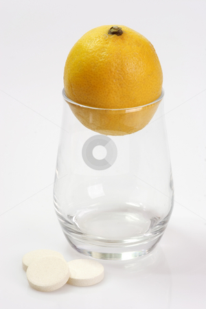 Lemon in glass stock photo, Effervescent tablets with glass and lemon on yellow background by Birgit Reitz-Hofmann