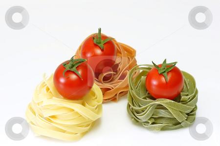 Noodles_10 stock photo, Raw pasta on bright background. Shot in Studio. by Birgit Reitz-Hofmann
