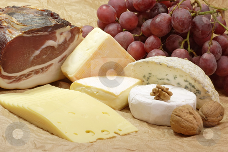 Smoked ham stock photo, Stillife with smoked ham and cheese on brown background by Birgit Reitz-Hofmann