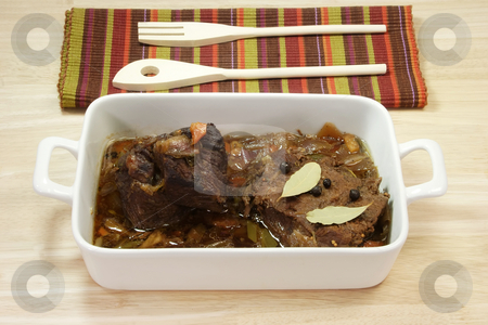 Marinated beef_2 stock photo, Cooked marinated beef meat in a bowl with wooden spoon. by Birgit Reitz-Hofmann