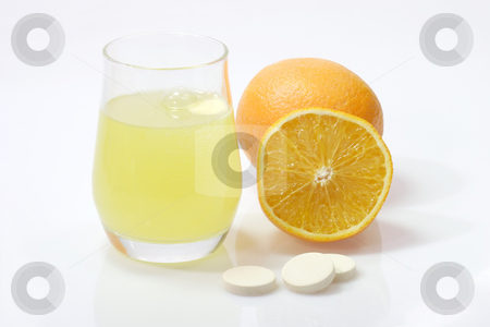 Healthy drink stock photo, Glas of fizzy liquid with Effervescent tablets on bright background by Birgit Reitz-Hofmann
