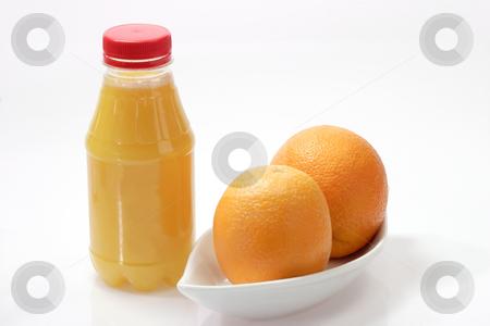 Two oranges stock photo, Orange juice on bright background by Birgit Reitz-Hofmann