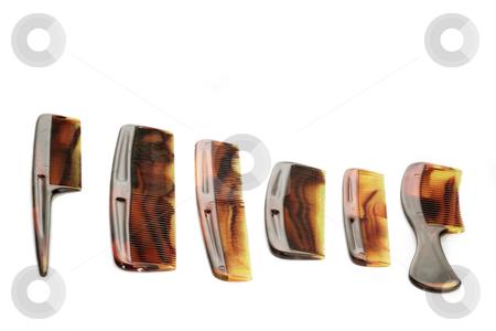 Brown combs stock photo, Combs on bright background. Shot in Studio by Birgit Reitz-Hofmann
