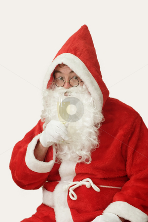 Merry Christmas stock photo, Male caucasian model of santa claus drinking a glass of champaigne - isolated on white background by Birgit Reitz-Hofmann