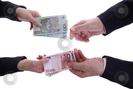 Money stock photo, Exchanging money isolated on white background by Jolanta Dabrowska