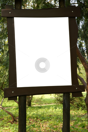 Noticeboard stock photo, Empty noticeboard placed in beautiful green forest by Jolanta Dabrowska