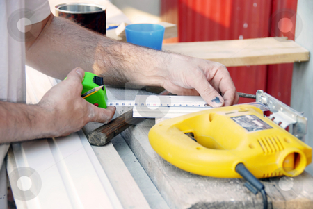 Working stock photo, Working man hands outdoor with instruments and tape-line by Julija Sapic