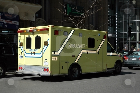 Ambulance in transit stock photo, Ambulance on the downtown streets rushing to hospital by Gary Nicolson