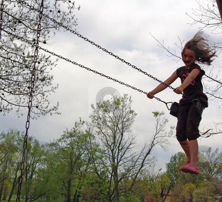 Swinging stock photo,  by Sandra Fann