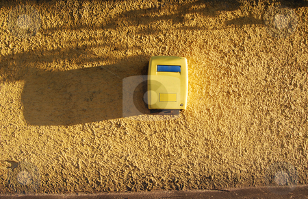 Yellow mailbox  stock photo, Postbox for sending letters on painted wall with trees' shadows by Leyla Akhundova