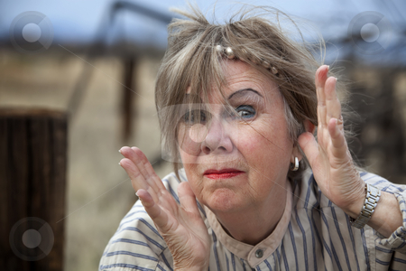 Crazy Woman stock photo, Crazy old woman outdoors with wild makeup by Scott Griessel