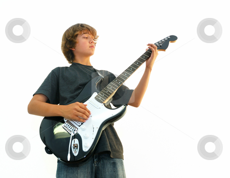 Teen Boy Playing Guitar stock photo, Teen boy playing electric guitar isolated over white. by Denis Radovanovic
