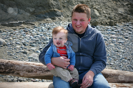 Father and Son stock photo, A young father and her son having fun at the beach. by Travis Manley