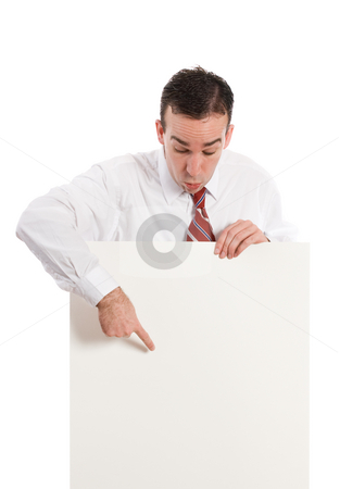Look Here stock photo, A businessman pointing to a spot the paper sign where you should look, isolated against a white background by Richard Nelson