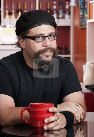 Man wearing beret in coffee house stock photo, Man with facial hair and beret in coffee house by Scott Griessel