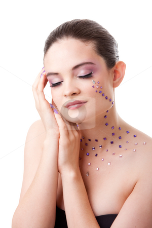 Beatiful woman with purple makeup stock photo, Headshot of a beautiful Caucasian woman with purple makeup and rhinestones with eyes closed, isolated by Paul Hakimata