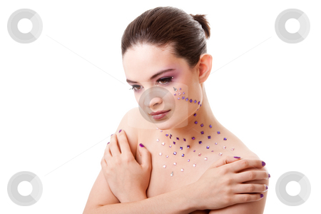Beautiful woman with purple makeup stock photo, Headshot of a beautiful Caucasian woman with purple makeup and rhinestones, isolated by Paul Hakimata