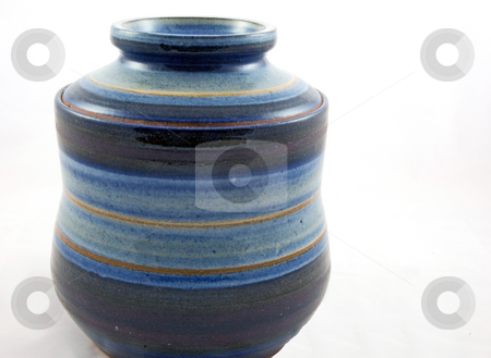Pottery Cookie Jar stock photo, This is a closeup of a handmade pottery in tones of blues used for a cookie jar and isolated on a white background. by Valerie Garner