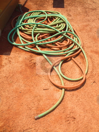 Water Hose stock photo,  by Michael Felix