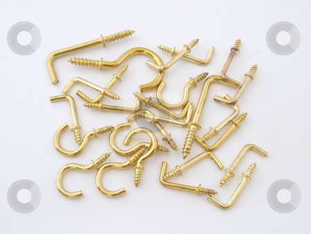 Assorted brass hookes. stock photo, Assorted brass hookes used for hanging light objects. by Ian Langley