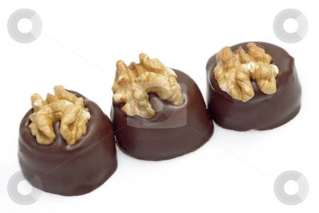 Pralines stock photo, Shot of some delicious chocolates on bright background by Birgit Reitz-Hofmann