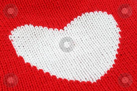Knitting Heart stock photo, Close up from white knitting heart on red. by Birgit Reitz-Hofmann