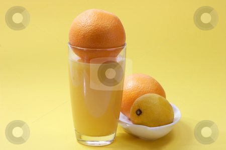 Orange juice stock photo, Orange juice on yellow background by Birgit Reitz-Hofmann