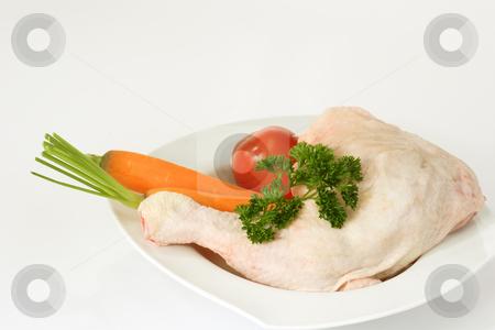 Chicken leg_8 stock photo, Raw chicken leg with vegetables on bright background by Birgit Reitz-Hofmann