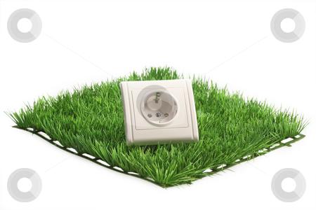 Power socket stock photo, Power socket on a grass meadow on bright background by Birgit Reitz-Hofmann