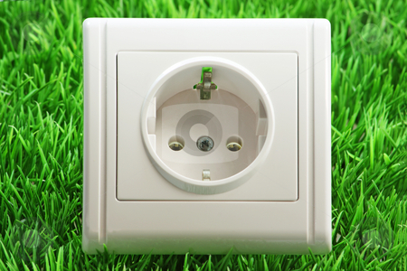 Power socket stock photo, Close up from a Power socket on a grass meadow as background by Birgit Reitz-Hofmann