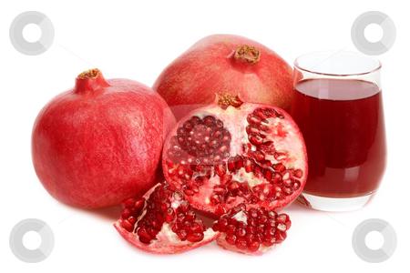 Pomegranate juice stock photo, Fresh pomegranate and juice on white background by Birgit Reitz-Hofmann