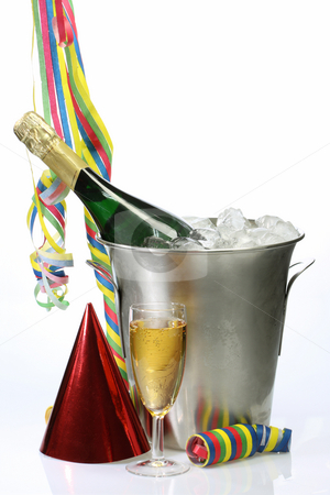 New Years Party stock photo, Champagne toast composition with streamers, hat and glass on bright background by Birgit Reitz-Hofmann