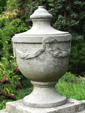 Granite urn stock photo, Ivy spilling over and around a granite urn by Birgit Reitz-Hofmann