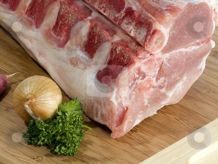 Pork meat stock photo, Fresh pork in detail meat on kitchen board by Birgit Reitz-Hofmann