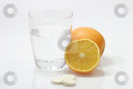 Vitamins stock photo, Glas of water with Effervescent tablets  on bright background by Birgit Reitz-Hofmann