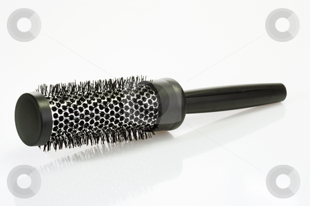 Plastic Hairbrush stock photo, Hairbrush on bright background. Shot in Studio by Birgit Reitz-Hofmann