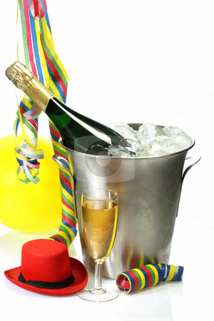 Carnival stock photo, Champagne toast composition with streamers and carnival hat on bright background by Birgit Reitz-Hofmann