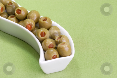 Olives stock photo, Green olives on green background by Birgit Reitz-Hofmann