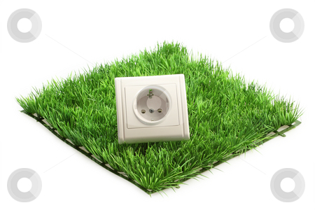 Economical stock photo, Power socket on a grass meadow on bright background by Birgit Reitz-Hofmann