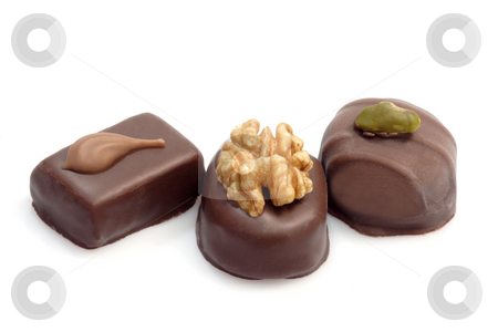 Chocolates stock photo, Shot of some delicious chocolates on bright background by Birgit Reitz-Hofmann