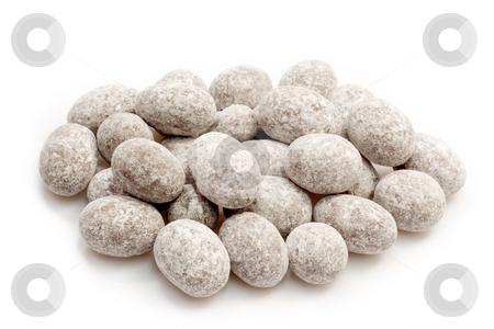 Sugared almonds stock photo, Sugared oval almond chocolates on bright background by Birgit Reitz-Hofmann