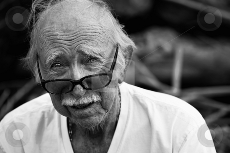 Elderly man in t-shirt and glasses stock photo, Elderly man outdoors wearing t-shirt and glasses by Scott Griessel