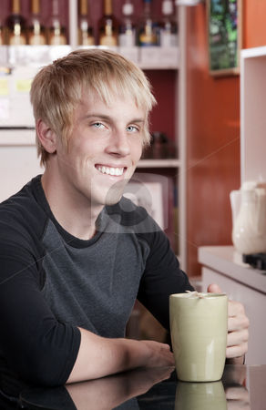 Coffee House Portrait of Young Man stock photo, Coffee House Portrait of Young Blonde Man by Scott Griessel