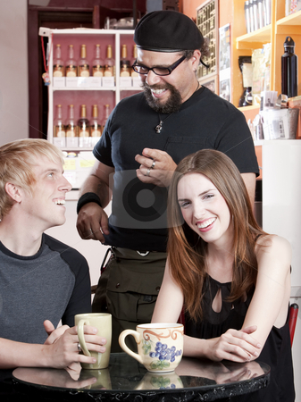 Coffee House Conversation stock photo, Three friends laughing together in a coffee house by Scott Griessel